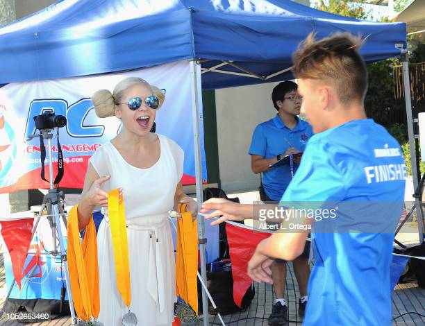 Actress/model Anne McDaniels passes out medals at Easter Seals Southern California's 'Strides For Disability 5K Run/Walk and 3K Family Fun Walk' held...
