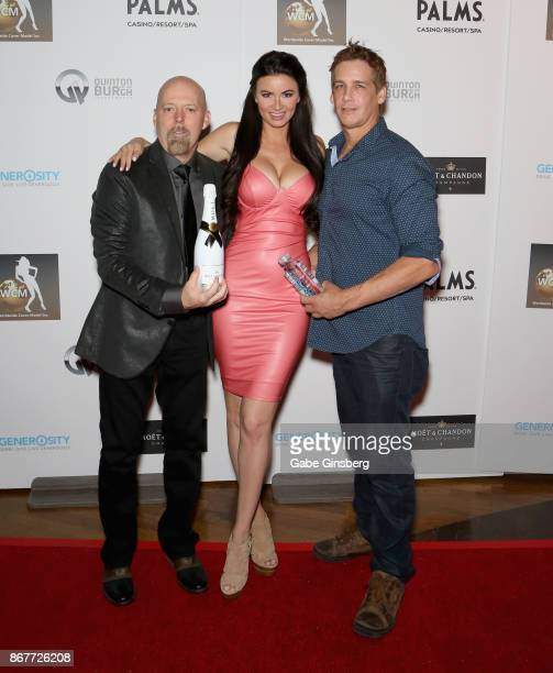 Actress/model April Rose poses with coowners of Worldwide Cover Model Inc Brian B Hayes and Jerry Shandrew during the Worldwide Cover Model Inc...