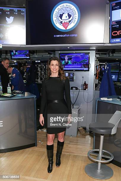 Actress/model Bridget Moynahan poses for photographs after ringing the New York Stock Exchange Closing Bell with The Hole in the Wall Gang Camp at...