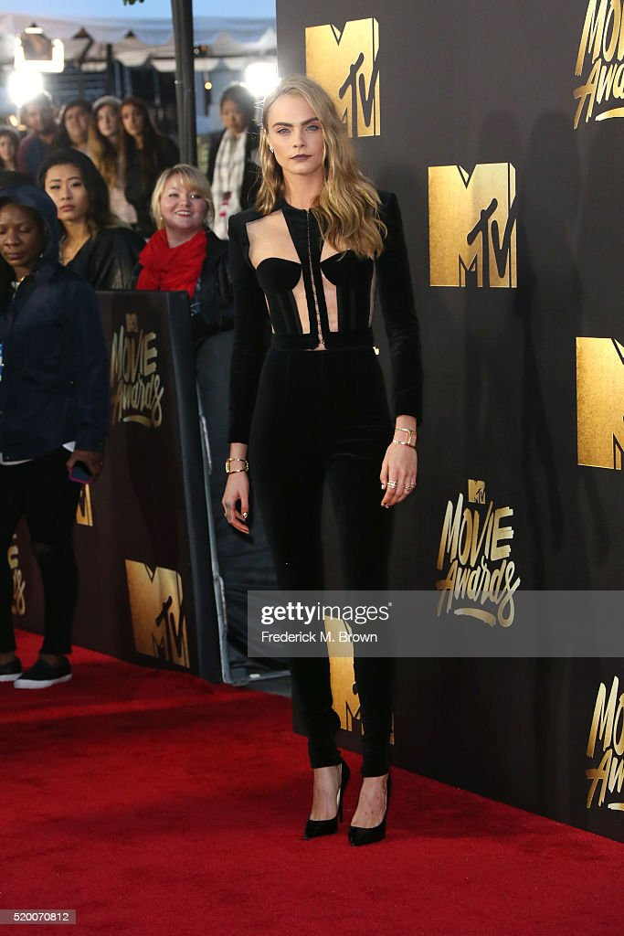 Actress/model Cara Delevingne attends the 2016 MTV Movie Awards at Warner Bros. Studios on April 9, 2016 in Burbank, California. MTV Movie Awards airs April 10, 2016 at 8pm ET/PT.