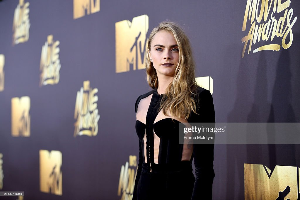 Actress/model Cara Delevingne attends the 2016 MTV Movie Awards at Warner Bros. Studios on April 9, 2016 in Burbank, California. MTV Movie Awards airs April 10, 2016 at 8pm ET/PT.
