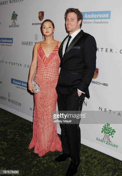 Actress/model Devon Aoki and James Bailey arrive at the 2nd Annual Baby2Baby Gala at The Book Bindery on November 9 2013 in Culver City California