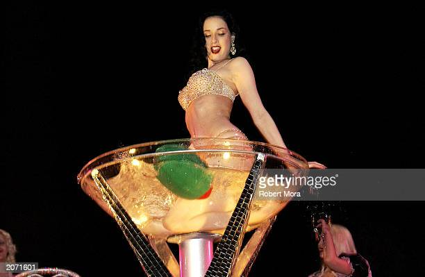 Actress/model Dita Von Teese performs a strip tease at the official launch party for Spike TV at the Playboy Mansion on June 10 2003 in Holmby Hills...