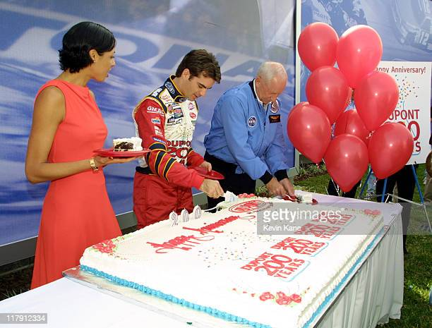 Actress/Model Drena De Niro watches as Winston Cup driver Jeff Gordon and Apollo 15 Astronaut Al Worden cut the huge DuPont Anniversary cake