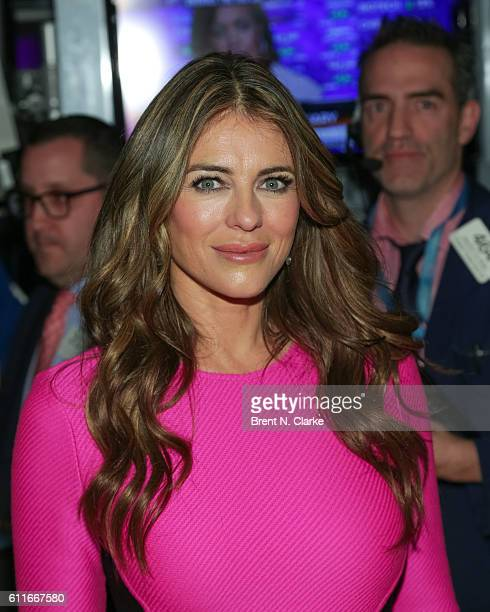 Actress/model Elizabeth Hurley poses after she and The Estee Lauder Companies ring the closing bell at the New York Stock Exchange to kick off the...