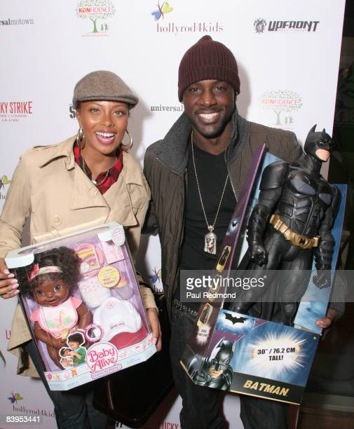 Actress/model Eva Pigford and actor Lance Gross attend Children's Holiday Bowl and Toy Drive benefiting the Children of South LA's youth center A...