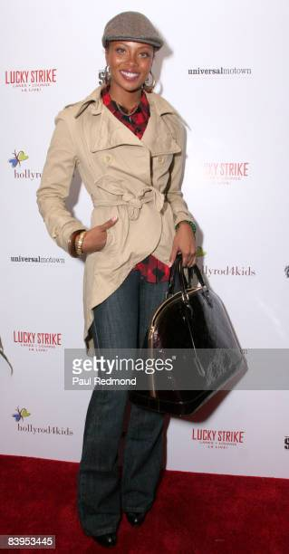 Actress/model Eva Pigford attends Children's Holiday Bowl and Toy Drive benefiting the Children of South LA's youth center A Place Called Home hosted...