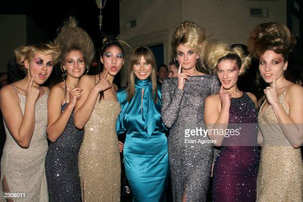 Actress/model Heidi Klum poses with bevy of beauty salon babes at Miramax Films' 'Blow Dry' screening afterparty at the WarrenTricomi Salon in New...