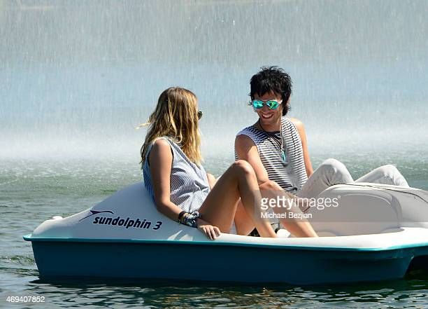 Actress/Model Keeley Hazell paddles a boat with Dominic Howard of 'Muse' at Riviera Brunch hosted by GREY GOOSE at Soho Desert House on April 11 2015...
