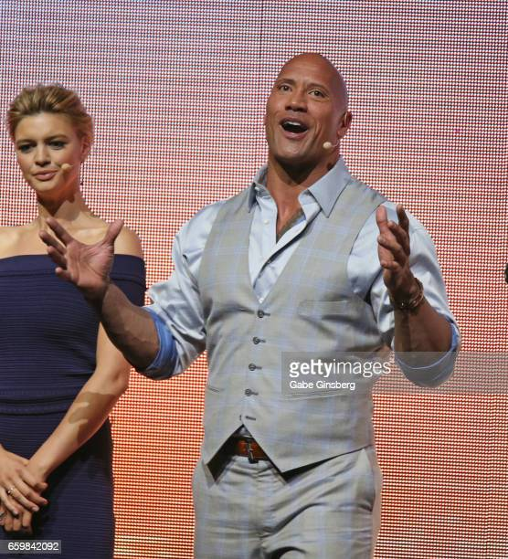 Actress/model Kelly Rohrbach and actor Dwayne Johnson speak at Paramount Pictures' presentation highlighting its 2017 summer and beyond during...