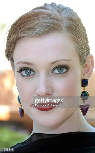 Actress/model Kelsey Collins presents a pair of custom ear rings by designers Jerry Skeels and Randy McLoughlin to be auctioned at the 2002 Tony...