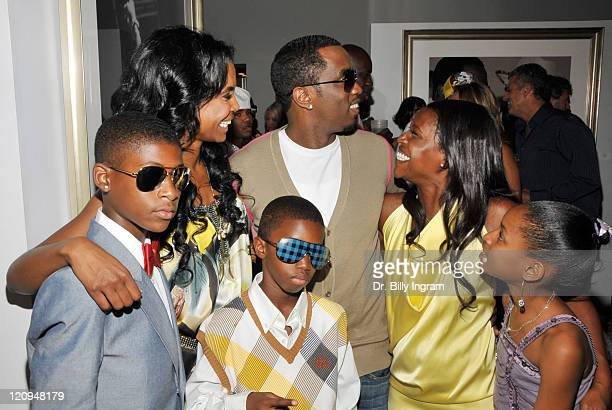 Actress/model Kim Porter and rapper/actor Diddy photographer Cheryl Fox and children attend the opening night for The Rock N Roll Of Hip Hop Photo...