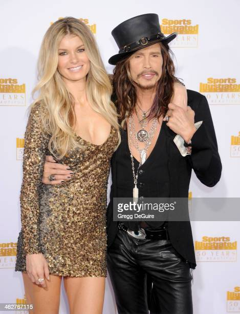 Actress/model Marisa Miller and singer Steven Tyler of Aerosmith arrive at the 50th Anniversary Celebration Of Sports Illustrated Swimsuit Issue at...