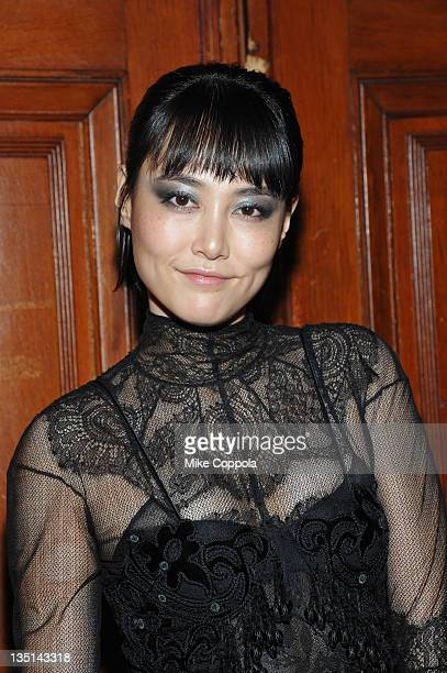 Actress/model Rinko Kikuchi attends the celebration of the global launch of the 2012 Pirelli Calendar by Mario Sorrenti gala dinner at the Park...