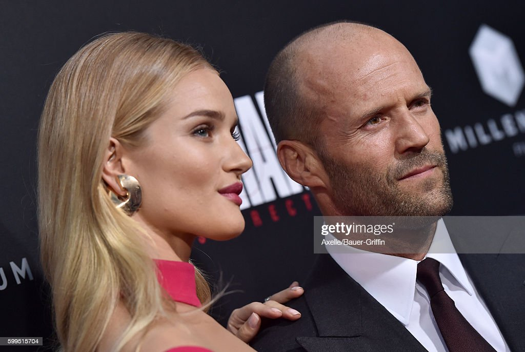 Actress/model Rosie Huntington-Whiteley and actor Jason Statham arrive at the premiere of Summit Entertainment's 'Mechanic: Resurrection' at ArcLight Hollywood on August 22, 2016 in Hollywood, California.