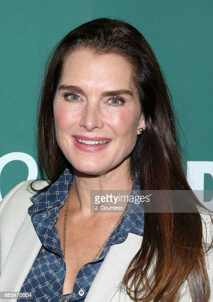 Actress/moderator Brooke Shields poses for a photo at a book signing for Ben Falcone's New Book 'Being a Dad Is Weird Lessons In Fatherhood from My...