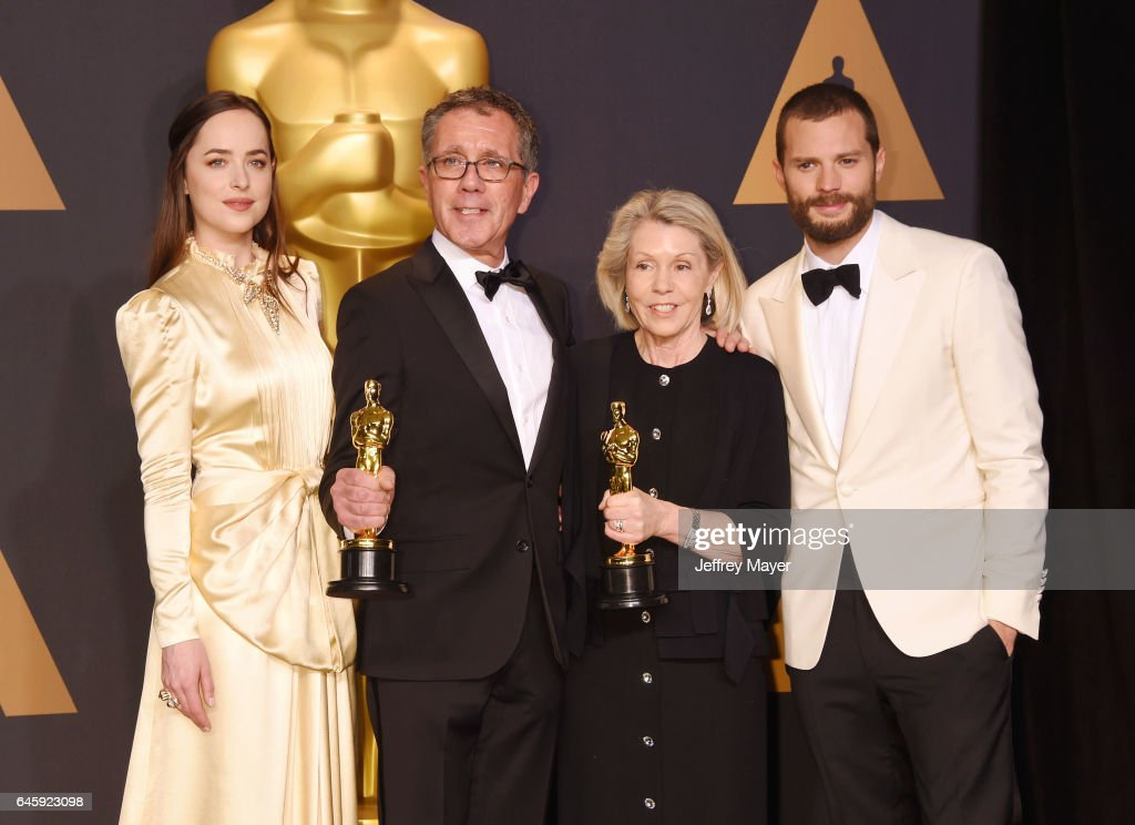 Actress-presenter Dakota Johnson, production designer David Wasco, set decorator Sandy Reynolds-Wasco, winners of the award for Production Design for 'La La Land,' and actor Jamie Dornan in the press room during the 89th Annual Academy Awards at Hollywood & Highland Center on February 26, 2017 in Hollywood, California. in the press room during the 89th Annual Academy Awards at Hollywood & Highland Center on February 26, 2017 in Hollywood, California.HOLLYWOOD, CA - FEBRUARY 26: (L-R) Actress-presenter Dakota Johnson; David Wasco; Sandy Reynolds-Wasco; Jamie Dornan poses in the press room during the 89th Annual Academy Awards at Hollywood & Highland Center on February 26, 2017 in Hollywood, California.