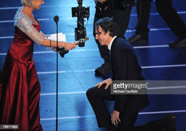 Actress/presenter Helen Mirren and actor Daniel DayLewis onstage during the 80th Annual Academy Awards at the Kodak Theatre on February 24 2008 in...