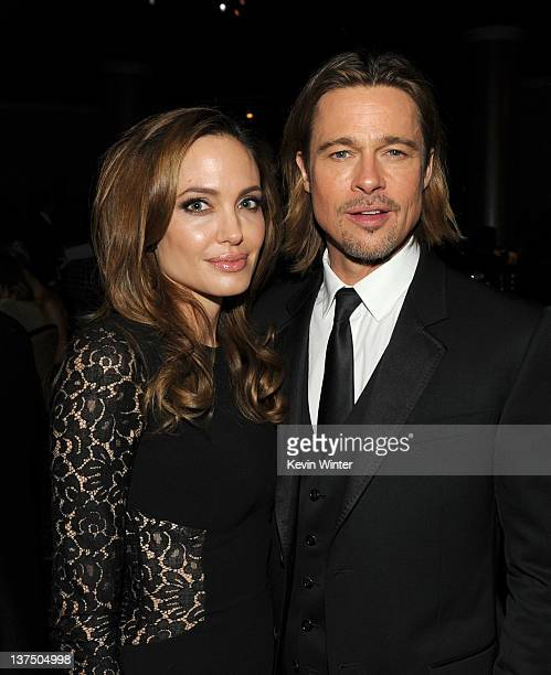 Actress/producer Angelina Jolie and actor Brad Pitt attend the 23rd annual Producers Guild Awards at The Beverly Hilton hotel on January 21 2012 in...