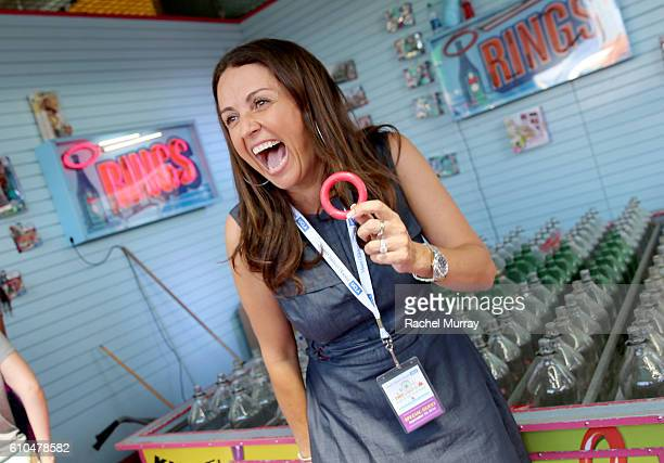 Actress/Producer Jenni Pulos plays Ring Toss with guests during the 17th Annual Mattel Party on the Pier on September 25 2016 in Santa Monica...