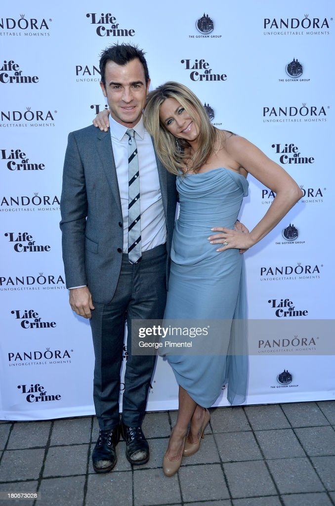 Actress/Producer Jennifer Aniston (R) (wearing Vivienne Westwood gown) and actor Justin Theroux attend the 'Life of Crime' cocktail reception presented by PANDORA Jewelry at Hudson Kitchen during the 2013 Toronto International Film Festival on September 14, 2013 in Toronto, Canada.