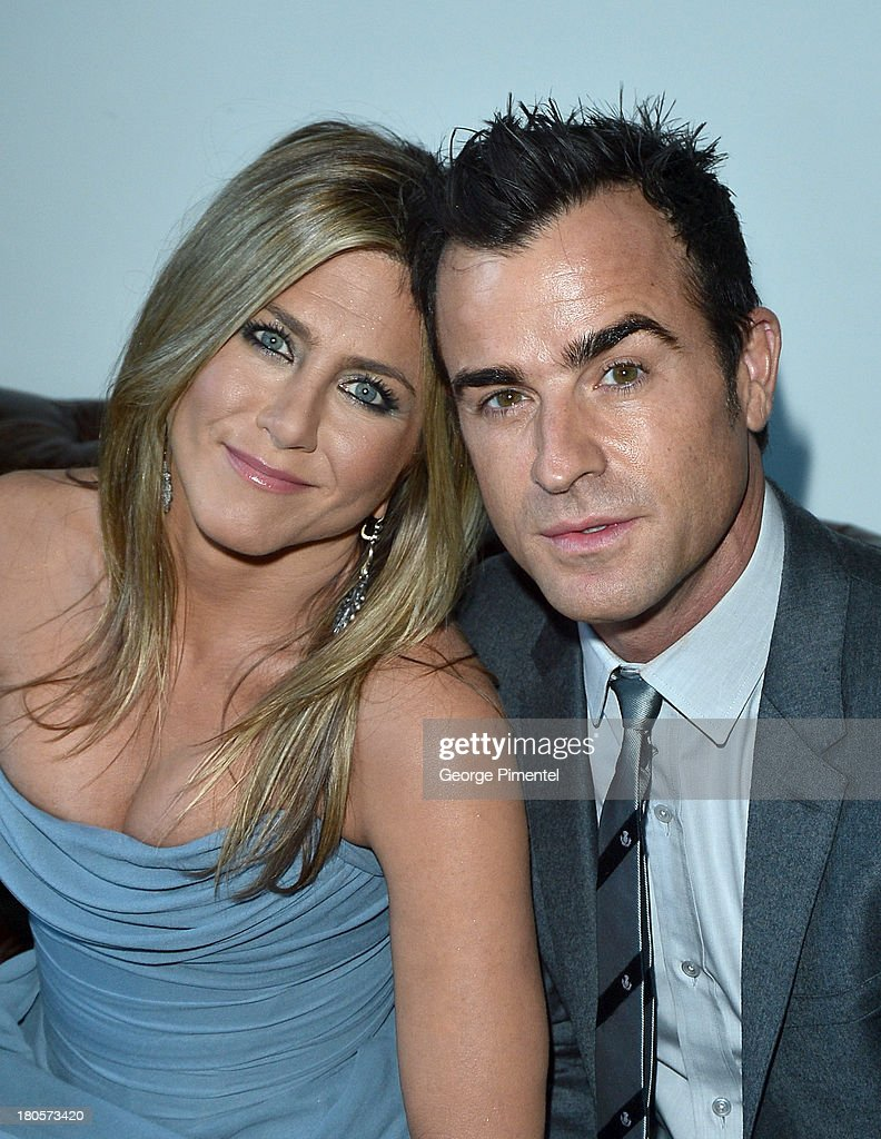 Actress/Producer Jennifer Aniston (L) (wearing Vivienne Westwood gown) and actor Justin Theroux attend the 'Life of Crime' cocktail reception presented by PANDORA Jewelry at Hudson Kitchen during the 2013 Toronto International Film Festival on September 14, 2013 in Toronto, Canada.