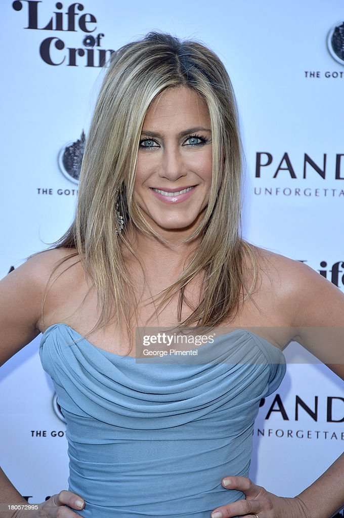 Actress/Producer Jennifer Aniston (wearing Vivienne Westwood gown) attends the 'Life of Crime' cocktail reception presented by PANDORA Jewelry at Hudson Kitchen during the 2013 Toronto International Film Festival on September 14, 2013 in Toronto, Canada.