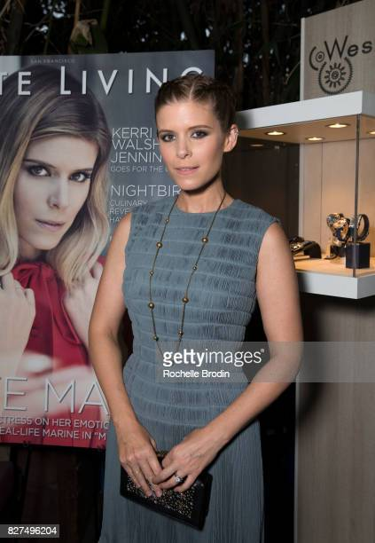 Actress/producer Kate Mara poses in front of her cover image at the Haute Living Celebrates Kate Mara with Westime event on August 7 2017 in Los...