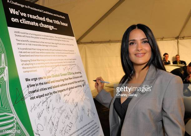Actress/producer Salma Hayek signs a Presidential Climate Action Challenge at Global Green USA's 5th Annual Pre Oscar Party raising awareness about...