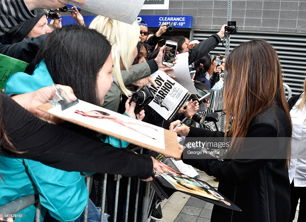 Actress/producer Sandra Bullock signs autographs for fans during the 'Our Brand Is Crisis' press conference at the 2015 Toronto International Film Festival at TIFF Bell Lightbox on September 12, 2015 in Toronto, Canada.
