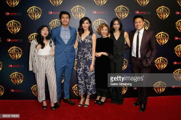 Actress/rapper Awkwafina actor Henry Golding actresses Gemma Chan Constance Wu Sonoya Mizuno and director Jon M Chu attend CinemaCon 2018 Warner Bros...