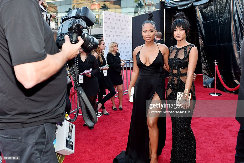 Actress/recording artist Christina Milian (L) and Karrueche Tran attend the 2015 American Music Awards at Microsoft Theater on November 22, 2015 in Los Angeles, California.