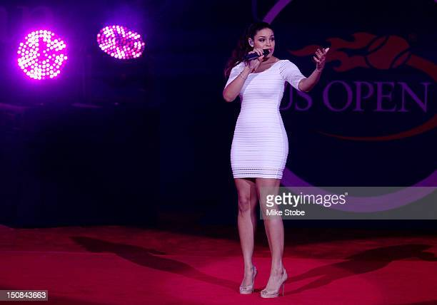 Actress/recording artist Jordin Sparks sings the national anthem during the opening ceremonies on Day One of the 2012 US Open at the USTA Billie Jean...