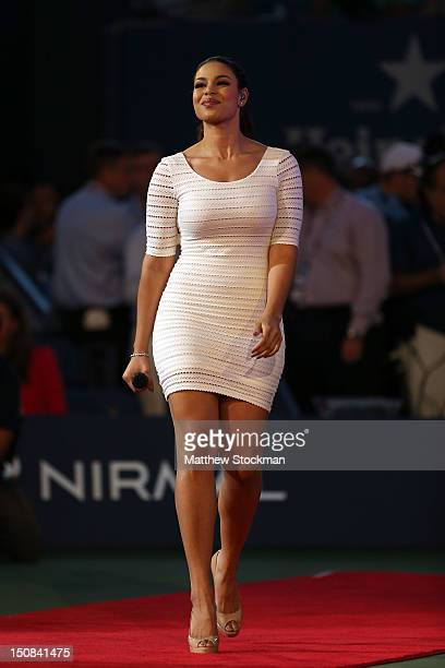 Actress/recording artist Jordin Sparks walks on the court during the opening ceremonies on Day One of the 2012 US Open at USTA Billie Jean King...