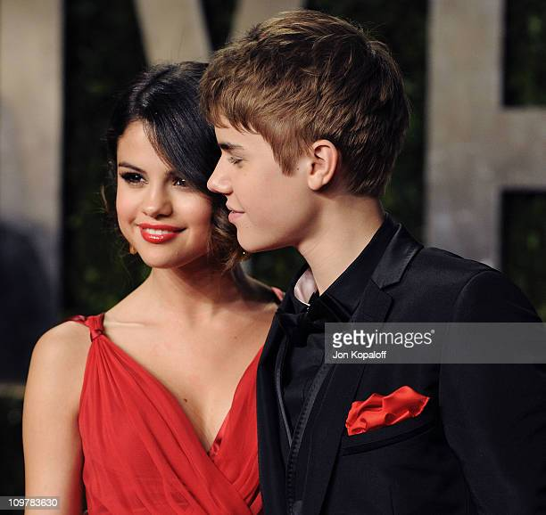 Actress/Recording artist Selena Gomez and recording artist Justin Bieber arrive at the Vanity Fair Oscar Party at Sunset Tower on February 27 2011 in...