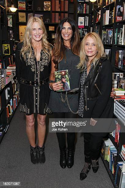 Actresss Daryl Hannah Hilary Shepard and Rosanna Arquette pose for a photo prior to Hilary Shepard book signing event for her mysterious new young...