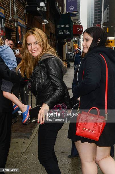 "Actresss Kelly Preston and Ella Bleu Travolta enter the ""Late Show With David Letterman"" taping at the Ed Sullivan Theater on April 20, 2015 in New..."