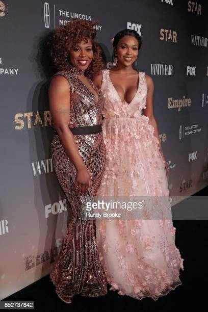 Actress's Ta'Rhonda Jones and Amiyah Scott pose on the red carpet during the 'Empire' 'Star' Celebrate FOX's New Wednesday Night at One World...