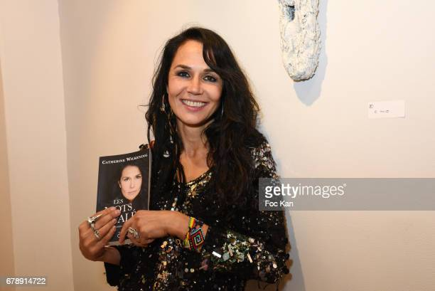 Actress/Sculptor/writer Catherine Wilkening poses with her book Les Mots Avales during Parcours D'une Vorace Catherine Wilkening Sculptures...