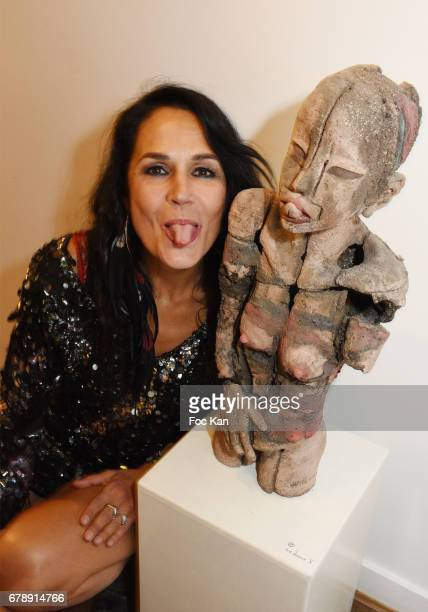 Actress/Sculptor/writer Catherine Wilkening poses with her work during Parcours D'une Vorace Catherine Wilkening Sculptures Exhibition Preview and...