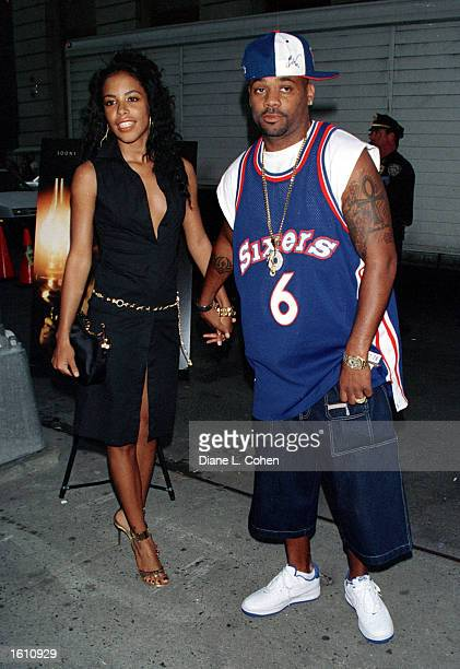 Actress/singer Aaliyah and her boyfriend Damon Dash attend the premiere of The Others August 2 2001 in New York City Aaliyah and eight others died in...