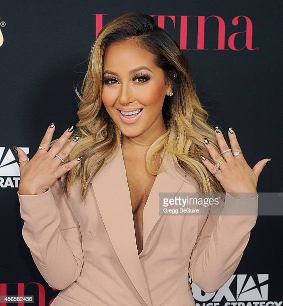Actress/singer Adrienne Bailon arrives at LATINA Magazine 'Hollywood Hot List' party at Sunset Tower Hotel on October 2 2014 in West Hollywood...