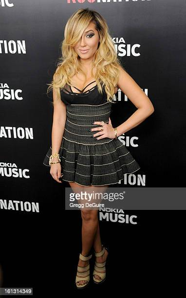 Actress/singer Adrienne Bailon arrives at Roc Nation PreGRAMMY brunch at Soho House on February 9 2013 in West Hollywood California