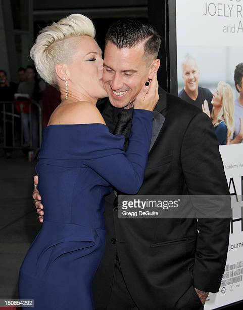 Actress/singer Alecia Moore and Carey Hart arrive at the Los Angeles premiere of 'Thanks For Sharing' at ArcLight Hollywood on September 16 2013 in...