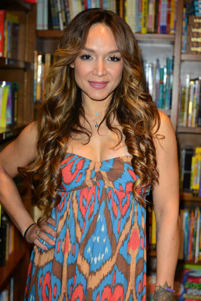Mayte Garcia Book Signing Photos And Images Getty Images - Dancer prince hairstyle