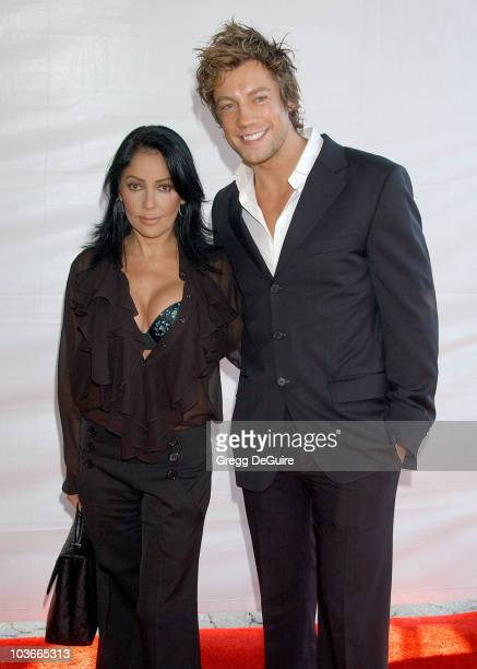 Actress/singer Apollonia Kotero and actor Emmanuel Delcour arrive at the 2007 World Magic Awards at the Barker Hanger on October 13 2007 in Santa...