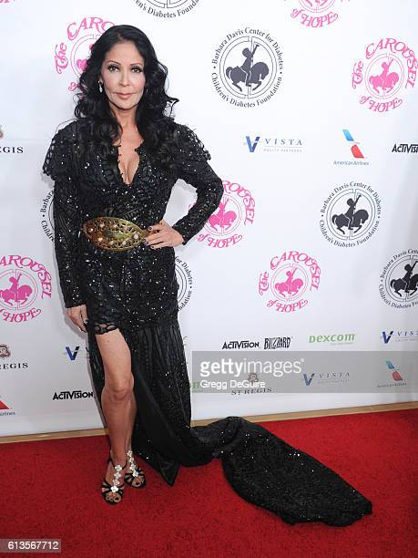 Actress/singer Apollonia Kotero arrives at the 2016 Carousel Of Hope Ball at The Beverly Hilton Hotel on October 8 2016 in Beverly Hills California