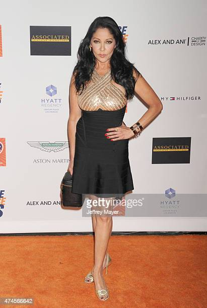 Actress/singer Apollonia Kotero arrives at the 22nd Annual Race To Erase MS at the Hyatt Regency Century Plaza on April 24 2015 in Century City...