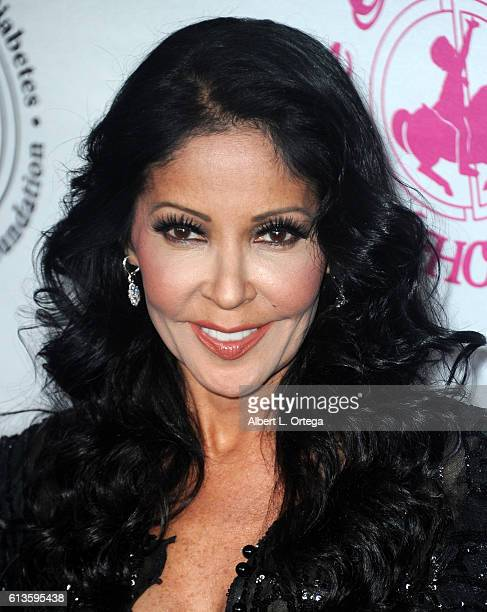 Actress/singer Apollonia Kotero arrives for the 2016 Carousel Of Hope Ball held at The Beverly Hilton Hotel on October 8 2016 in Beverly Hills...