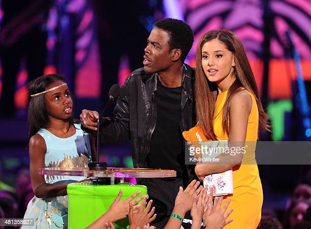 Actress/singer Ariana Grande accepts the Favorite TV Actress award onstage from actor Chris Rock and daughter Zahra onstage during Nickelodeon's 27th...